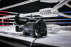 Camcorder stands on corner ring for mixed martial arts. Professional camcorder stands on corner ring for mixed martial arts. live broadcast competition in MMA Royalty Free Stock Image