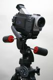 Camcorder on the tripod. Mini-DV camcorder fixed on the tripod Royalty Free Stock Photo