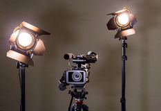 Camcorder and the two spotlights with Fresnel lenses Stock Photography