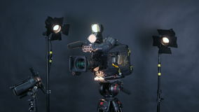 Camcorder, video camera and professional studio lights in a broadcasting studio. stock video footage