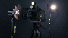 Camcorder, video camera and professional studio lights in a broadcasting studio. stock footage