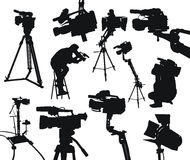 Camcorders. The black silhouttes of different camcorders and cameramen on white background Stock Photography