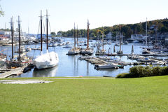 Camden Harbor in Maine. Many boats docked in the harbor in Camden Maine on a beautiful autumn day Stock Image