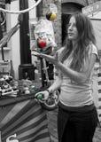 Camden juggler. Girl juggling balls in Camden Market Royalty Free Stock Photography