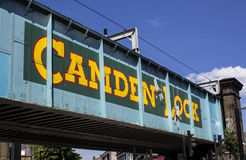 Camden Lock bridge. London, UK - 27 May 2013: A train bridge in Camden with the words Camden Lock. Around this famous area in Camden, you will find shops Royalty Free Stock Images