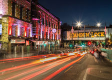 Camden Lock at Night. LONDON, UK - 17TH JULY 2015: The outside of buildings and a bridge in Camden Lock at night. The trails of traffic can be seen Royalty Free Stock Images