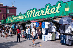 Camden Market in London. People walk past the Camden Market in London on August 21, 2013. Camden Town is London's most popular open-air market area with stalls Royalty Free Stock Photo