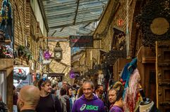 Camden Market. Visitors or buyers in Camden Market, where is found many kinds of clothes, vintage objects and handcrafts Royalty Free Stock Photography