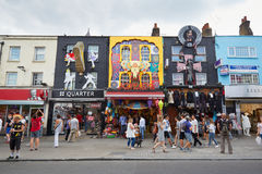Camden Town colorful shops with people in London. Camden Town colorful shops with people on August 8, 2015 in London, UK. Typical of the markets are the goth and royalty free stock image