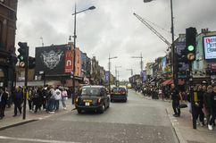 People and traffic on street in Camden Town London England. Camden Town London Great Britain, October 13 2017,  People and traffic on street, Nice outdoors image Royalty Free Stock Image