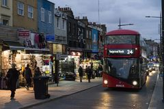 People and traffic on street at dusk in Camden Town London Royalty Free Stock Photo