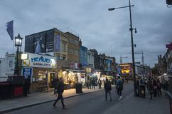 People and traffic on street at dusk in Camden Town London Stock Photography