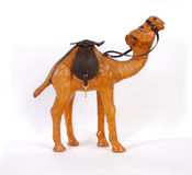 Camel. Cut out from a tree, this tiny figure - a beautiful gift, an element of a decor and interior addition Stock Images