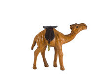 Camel. Small wooden figurine of a camel close up isolated on background Royalty Free Stock Images