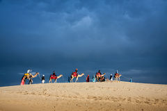 Camel caravan on desert in profile against cloud blue sky backgr Stock Photography