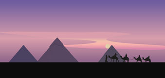 Camel Caravan and the Pyramids Royalty Free Stock Photo
