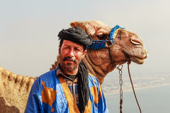 Camel driver with his camel Royalty Free Stock Photography
