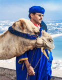 Camel driver on the mountain Royalty Free Stock Photos