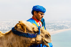 Camel driver on the mountain Royalty Free Stock Image
