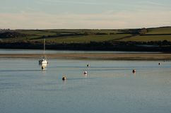 The Camel estuary at Padstow, Cornwall. A yacht moored and buoys on the river Camel at Padstow, Cornwall Stock Photography