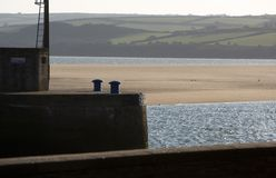 Camel estuary. View across the harbour wall at Padstow, Cornwall, UK to the Camel Estuary at low tide showing the sand bar Royalty Free Stock Images