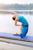 Camel Frog Hybrid Backbend yoga pose practiced at the river bank Royalty Free Stock Photos