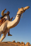 Camel and his cameleer. royalty free stock photography