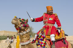 Camel and indian men wearing traditional Rajasthani dress participate in Mr. Desert contest as part of Desert Festival in Jaisalme Royalty Free Stock Photography