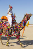 Camel and indian men wearing traditional Rajasthani dress participate in Mr. Desert contest as part of Desert Festival in Jaisalme Stock Photo