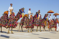 Camel and indian men wearing traditional Rajasthani dress participate in Mr. Desert contest as part of Desert Festival in Jaisalme Royalty Free Stock Images