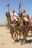 Camel and indian men wearing traditional Rajasthani dress participate in Mr. Desert contest as part of Desert Festival in Jaisalme. JAISALMER, INDIA - FEBRUARY Stock Images