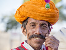 Camel and indian men wearing traditional Rajasthani dress participate in Mr. Desert contest as part of Desert Festival in Jaisalme. JAISALMER, INDIA - FEBRUARY Stock Photography