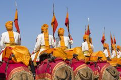 Camel and indian men wearing traditional Rajasthani dress participate in Mr. Desert contest as part of Desert Festival in Jaisalme. JAISALMER, INDIA - FEBRUARY Royalty Free Stock Images