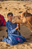 Camel kiss Cameleer on sand dune Royalty Free Stock Image