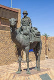 Camel monument in Upington, South Africa. A life-size statue in the town of Upington honouring the camel used by mounted police in the Kalahari desert and arid royalty free stock photo