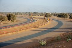 Camel Racing is an Arabian Gulf tradition. This camel race track shows the curve of the sandy track in the evening sun. Camel Racing is an Arabian Gulf royalty free stock photo