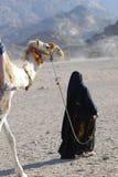 Camel ride - berberian woman. Camel, ride, trip, excursion, Egypt, Africa, Arab, Beduin, desert, woman, black royalty free stock photo