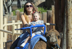 A Camel Ride at The Reid Park Zoo. Tucson, Arizona - February 17: The Reid Park Zoo on February 17, 2015, in Tucson, Arizona. A mother and daughter take a camel stock photos