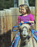 A Camel Ride at The Reid Park Zoo. Tucson, Arizona - February 17: The Reid Park Zoo on February 17, 2015, in Tucson, Arizona. A pair of girls take a camel ride stock image