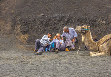 Camel riders wait for tourists Stock Images