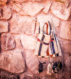 Camel Saddle Bag. Hung against stone cut wall Royalty Free Stock Photography