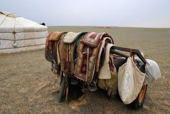 Camel saddles, Mongolia. A nomadic herder's camel saddles, propped on a trailer outside a ger in the Gobi Desert, Mongolia royalty free stock photo