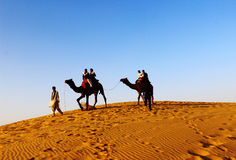 Camel safari at Jaisalmer thar desert India. Sunset sand with camel silhouette and people safari In Thar desert India stock photos