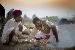 Camel trader in pushkar camel fair. Unidentified person and a trader in pushkar camel tradee fair in rajasthan, india on november 2015 Royalty Free Stock Photos