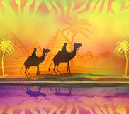 Camel train silhouetted against colorful sky crossing the Sahara Royalty Free Stock Photos