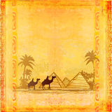 Camel train. Silhouetted against  sky crossing the Sahara Desert Stock Images