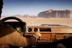 Camel trophy. Driving fast in the desert Stock Photos