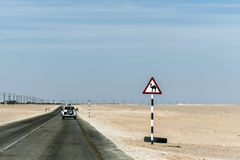 Camel warning sign desert highway in dhofar salalah Oman Middle East Royalty Free Stock Photos