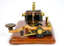 Camelback antique Morse key. A Camelback Morse key and sounder dating from around 1860. This type of key was used on the American telegraph system. It gains its royalty free stock photos