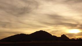 Camelback Mountain,Phoenix,Scottsdale Arizona. Phoenix,Scottsdale Arizona most recognizable mountain Camelback glows as sun sets beyond its camel shaped outline stock footage